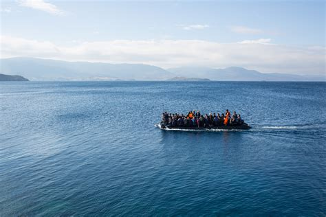 overcrowded refugee boat finland turns to blockchain to help unbanked refugees