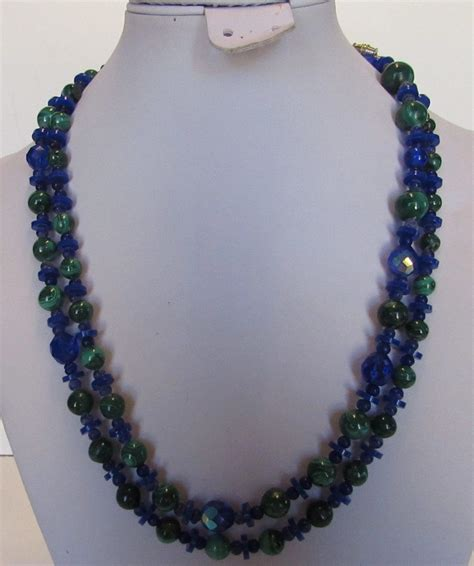 just looks cozy but id replace the crystal chandeliers vintage malachite bead and blue crystal necklace style