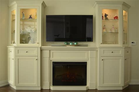 custom wall unit with electric fireplace for a condo