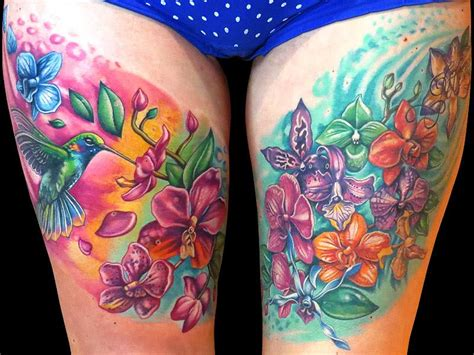 Leg Colorful colorful flowers and hummingbird tattoos on both thigh