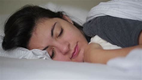 laid down in bed cute little girl 8 years on a bed close up stock footage