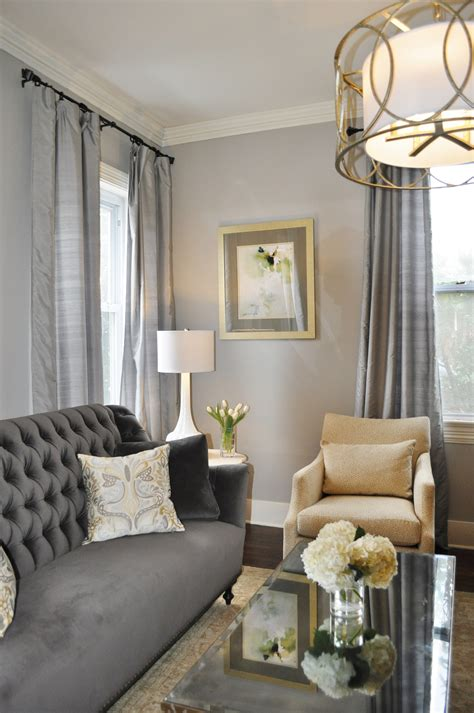 gold accessories for living room gray traditional living room gray living room tufted sofa gold accents mirrored