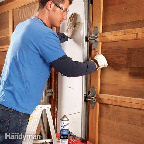 Squeaky Garage Door Fix by How To Fix A Noisy Garage Door The Family Handyman