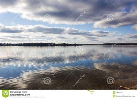 green lake boat launch michigan cloud reflection on lake royalty free stock photography