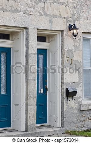 two front doors on a house stock photo of house and blue front doors a set of two front doors csp1573014