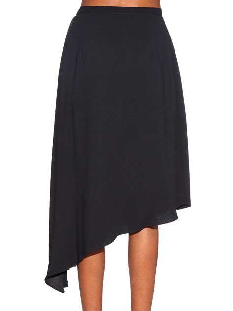 carven pleated satin midi skirt in black lyst