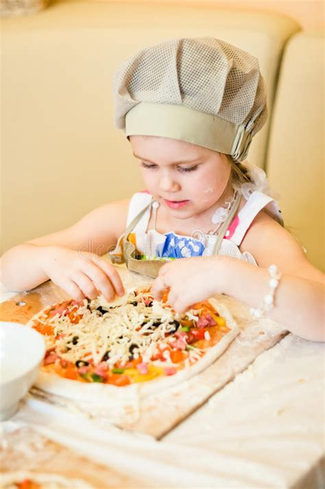 tor cheese pizza girls little girl adding cheese in pizza stock photo image