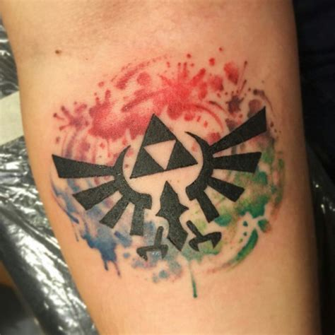 watercolor tattoo zelda this playful triforce on watercolor splatters awesome