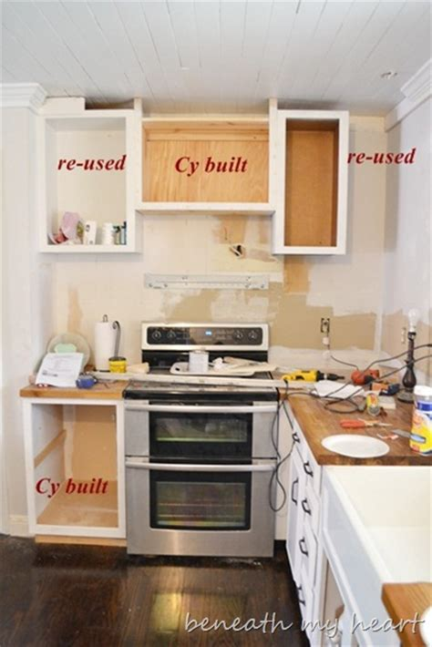 our diy under the cabinet cook book holder beneath my heart diy kitchen cabinet shelves home fatare