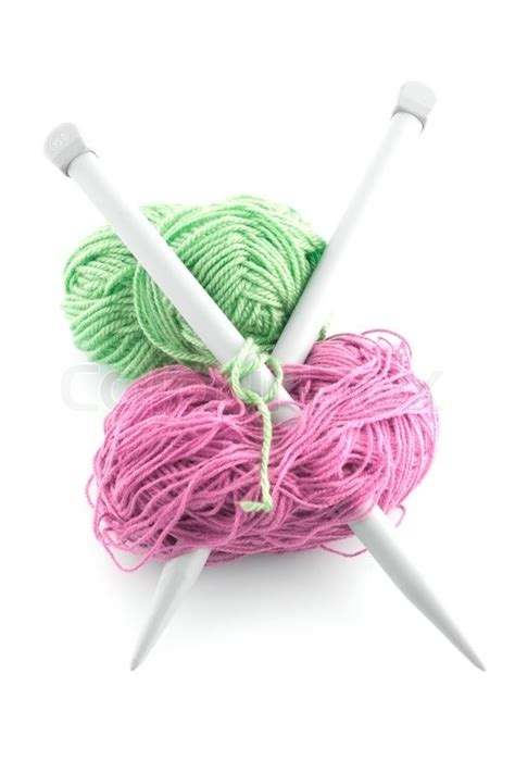 knitting needles and yarn balls of green and pinkknitting wool or yarn with silver