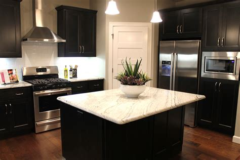Frosted Glass Backsplash In Kitchen by How To Choose Between Light And Dark Granite Katie Jane