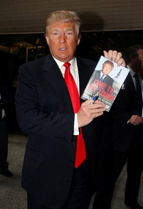 donald trump zimbio donald trump holds pictures of himself zimbio