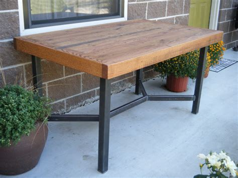 dining table oak with welded steel legs by two brothers