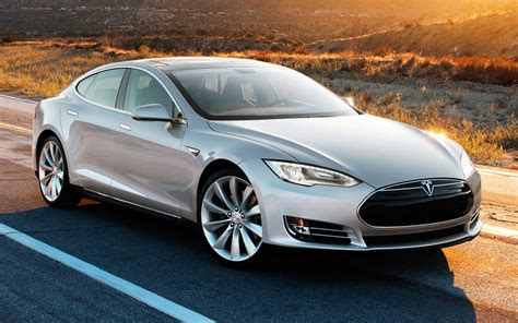 tesla to issue new stock and pay government loan