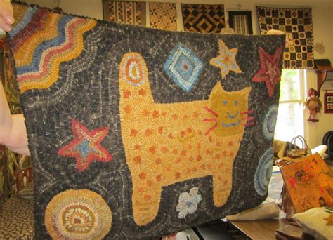 atha rug hooking back to larkrise the cutest hooked cat quilt blocks and a huswife