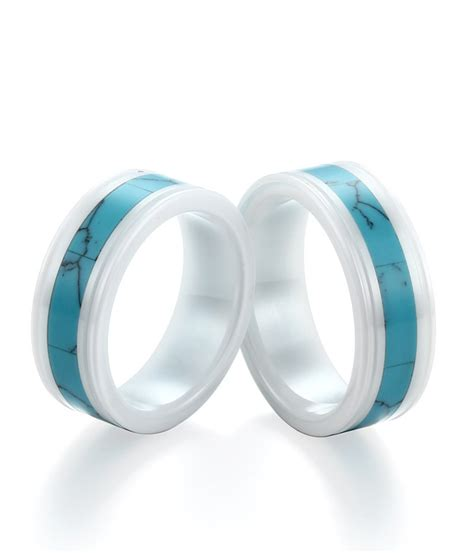 white ceramic wedding bands with turquoise inlay by