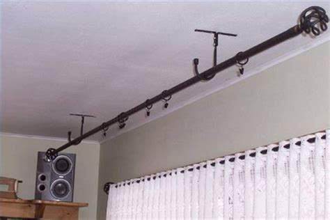 how to hang curtain rods from ceiling hang curtains from ceiling 171 ceiling systems