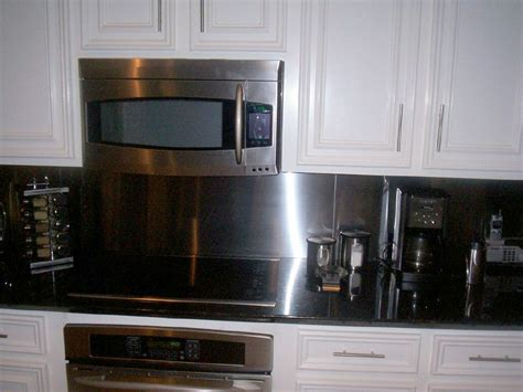 kitchen with stainless steel backsplash black counter with stainless steel backsplash kitchens i