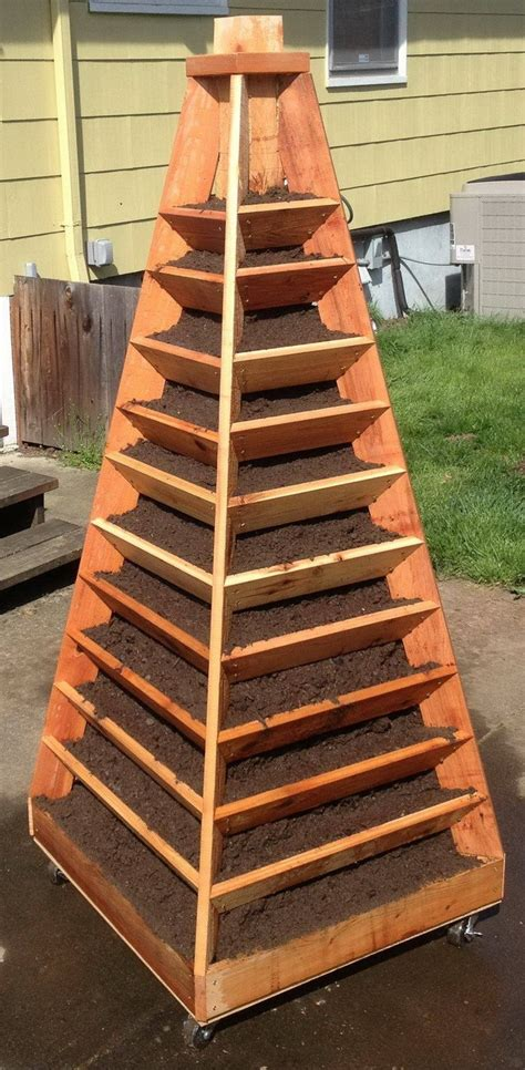 Garden Tower Planter diy garden tower planter idees and solutions
