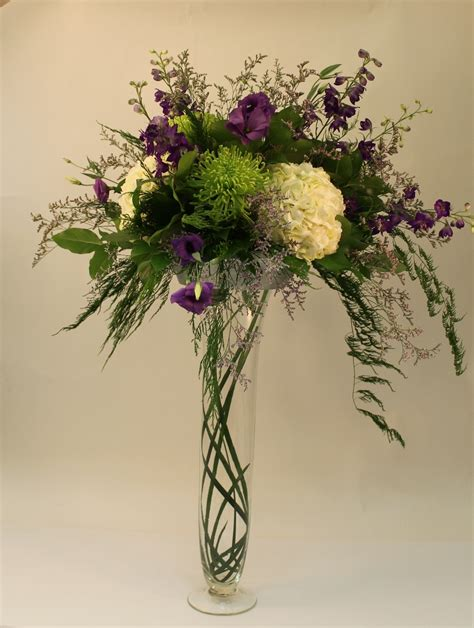 How To Design A Flower Vase by Flower Arrangements In Glass Vases With