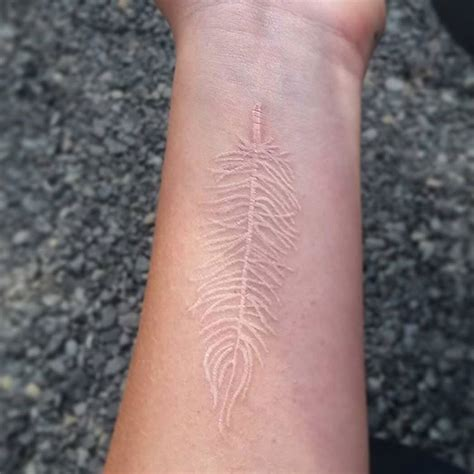 white tattoo on dark skin 40 beautiful white ink tattoos you will
