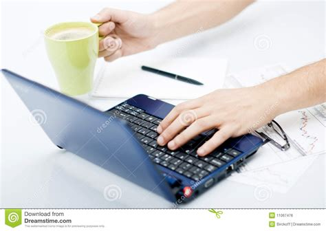 Front Desk Work by Desk Work In Front Of Computer With Coffee On One Royalty