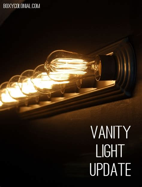 updating bathroom light fixtures quick and easy vanity light update plus black paint reveal
