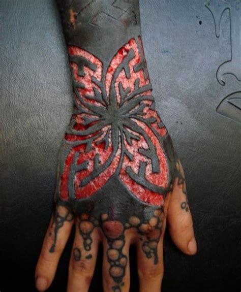 extreme tattoo ajax website mega extreme tattoos scarification slices away top layer