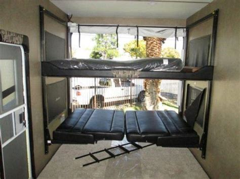 toy hauler bed lift toy hauler dual couch bed lift system happijac rv s
