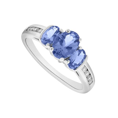 9ct white gold tanzanite and three ring