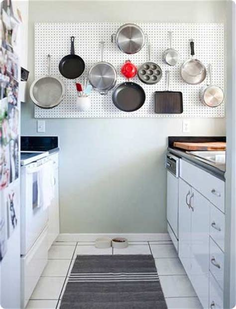 Pegboard Ideas Kitchen Free Up Storage Space In Cupboards By Using A Wall Mounted Peg Board To Store Pots Pans