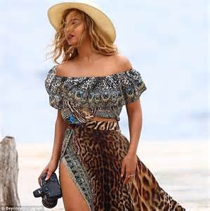 Beyonce Shows Trend High Belted Waists by Beyonce Dons A Bathing Suit With Blue During