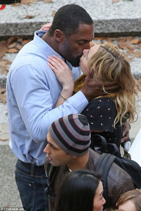 film blue us kate winslet shares a steamy smooch with idris elba on set