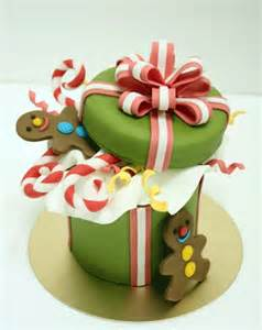 we love this christmas cake decorated as a gift box filled
