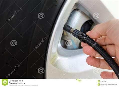 Filling Car Tires Air Filling Air Into A Car Tire Stock Photo Image 41624757
