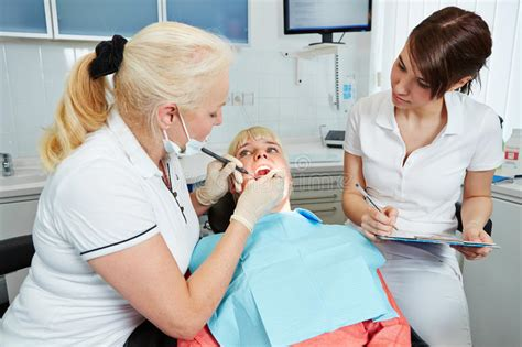 Dental Assistant Working by Dental Assistant During Apprenticeship Dentist Stock Image Image Of Tooth Dentist