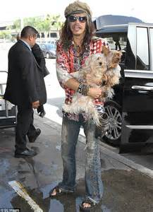 Jo In Dogs Out Kettle Intl steven carries his dogs to take flight out of lax