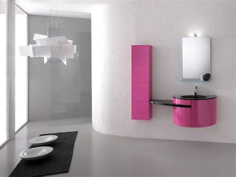 minimalist bahtroom vanity with pink storage and black sink with square mirror dweef