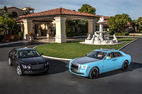 bentley rolls royce 2014 rolls royce ghost vs 2014 bentley flying spur