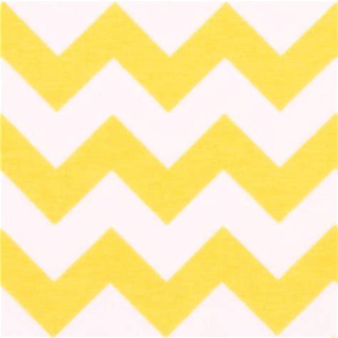 yellow pattern on white white riley blake knit fabric with yellow chevron pattern