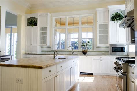 kitchen cabinets with windows bring natural light into your kitchen with these tips