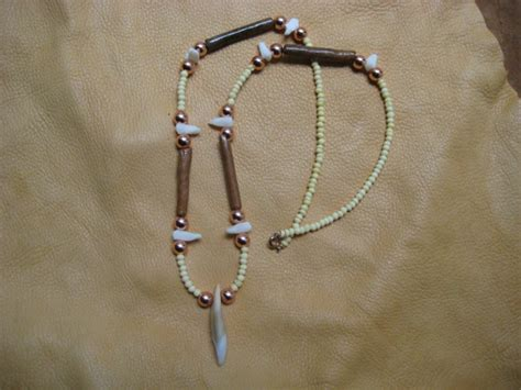 wolf tooth and bone necklace by lupagreenwolf on deviantart