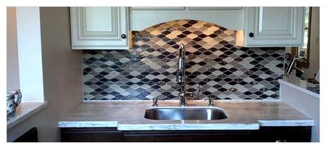 wave shaped glass tile kitchen backsplash