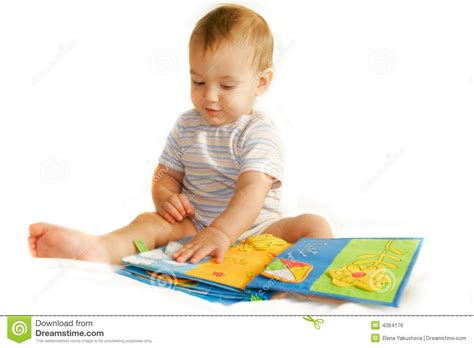 baby picture book baby boy reading a book stock photo image of image