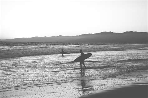 surf wallpaper black and white free stock photo of black and white surfer surfing