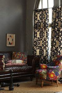 curtains  gray walls  brown leather couch