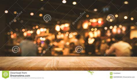 wood table top bar  blur light bokeh  dark night