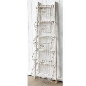 white wooden ladder storage shelf metal baskets shelves