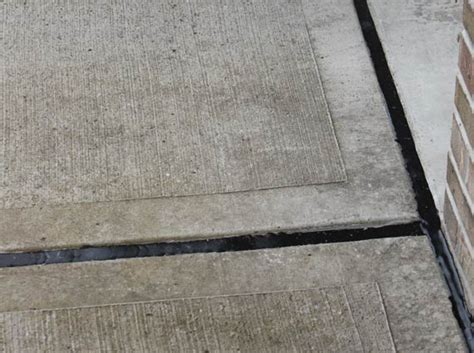 Filling Gaps Between Patio Slabs by Concrete Driveway Restoration Preservation A1 Concrete