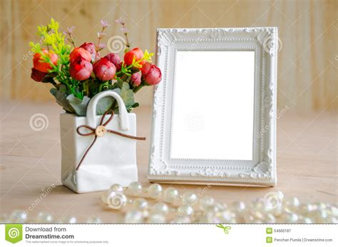 Picture Frame Vase by Flowers Vase And Blank White Picture Frame Stock Photo
